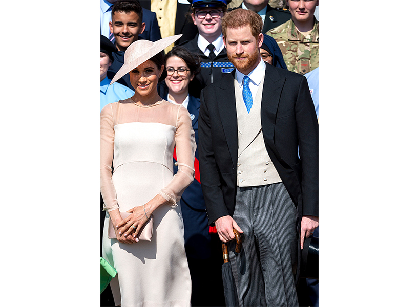 Meghan Markle and Prince Harry standing together smiling