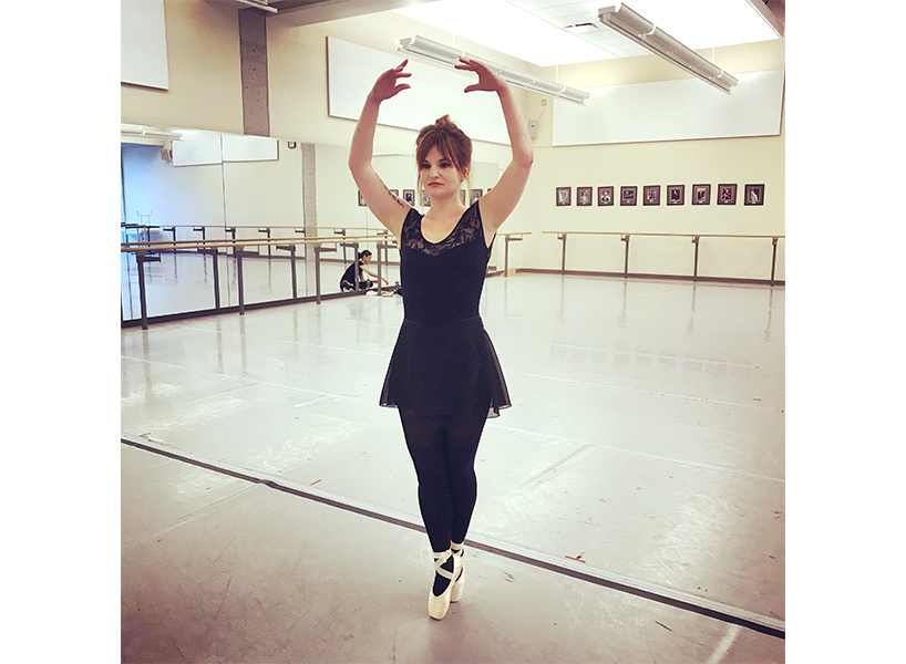 Adult ballet lessons: Writer Anne Thériault in a black leotard at a ballet studio-inline