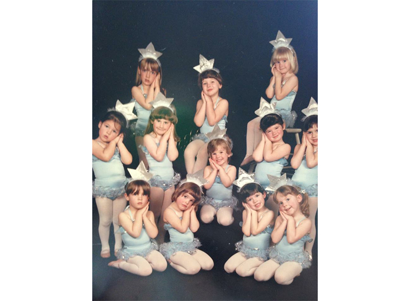 Anne Thériault as a child with the other girls in her ballet class, all wearing baby blue leotards-inline