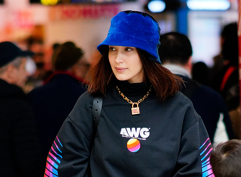 Bella Hadid wears a bucket hat and AWG top.