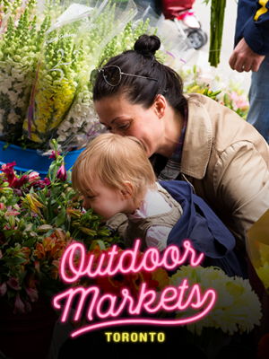 Best outdoor markets in Toronto - mother and kid smells flowers