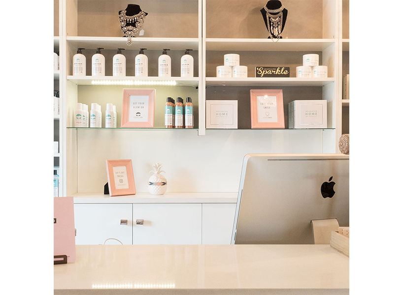 The front desk at Edmonton's OrganicTan with products, one of the best places to get a spray tan in Canada