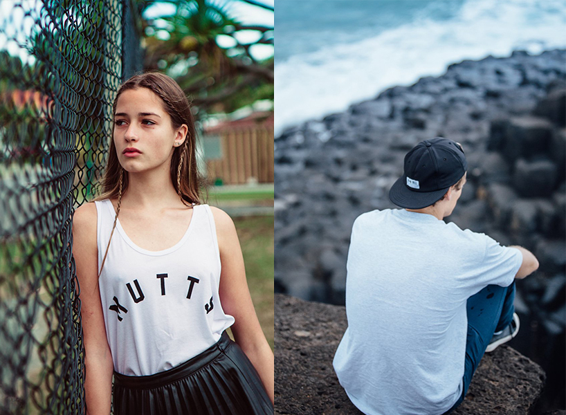 Two models wearing white t-shirts, one overlooking the ocean and the other leaning on a fence, Two models wearing mesh tank tops, camo pants and blue leggings, Canadian unisex designers Muttonhead