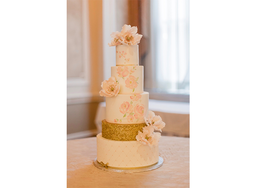 Wedding cakes Ottawa: A floral and gold cake from Ottawa's The Girl With the Most Cake, one of the best wedding cakes in Canada