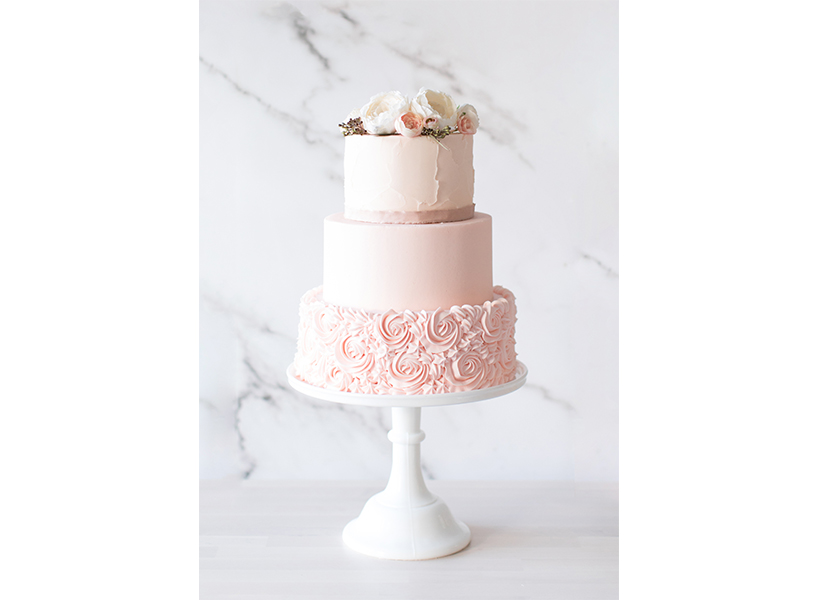 A pink rose cake from Saskatoon's Crave, one of the best wedding cakes in Canada