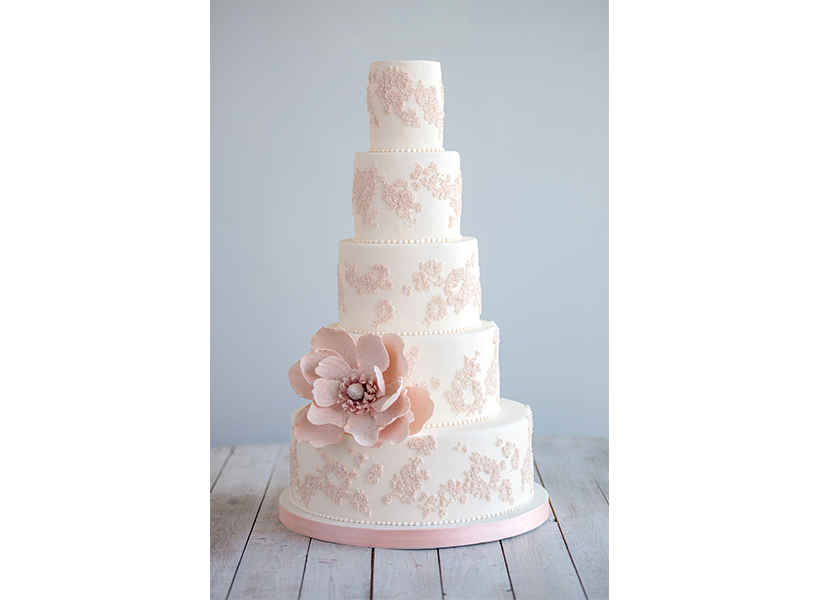 A floral and peal pink and white cake from Toronto's Bobbette & Belle, one of the best wedding cakes in Canada