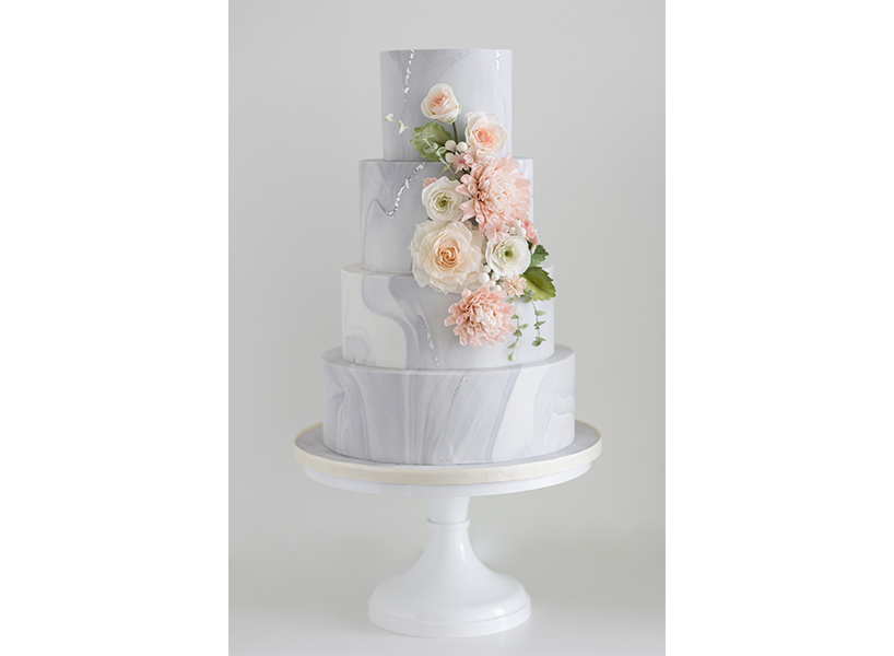 A grey marble cake with flowers from Vancouver's Cake By Annie, one of the best wedding cakes in Canada