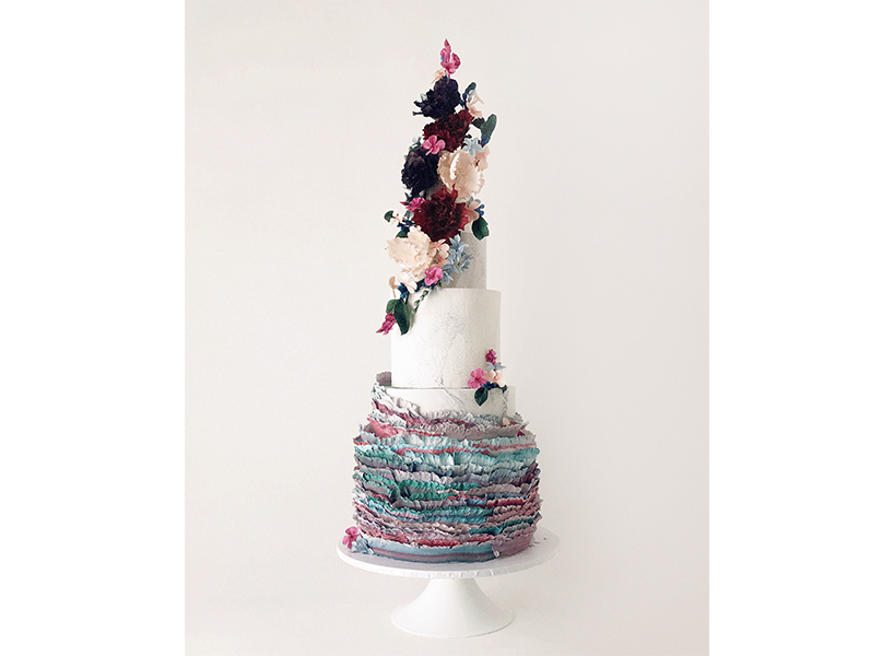 Wedding cakes Winnipeg: A floral and white ruffled cake from Winnipeg's Jenna Rae Cakes, one of the best wedding cakes in Canada