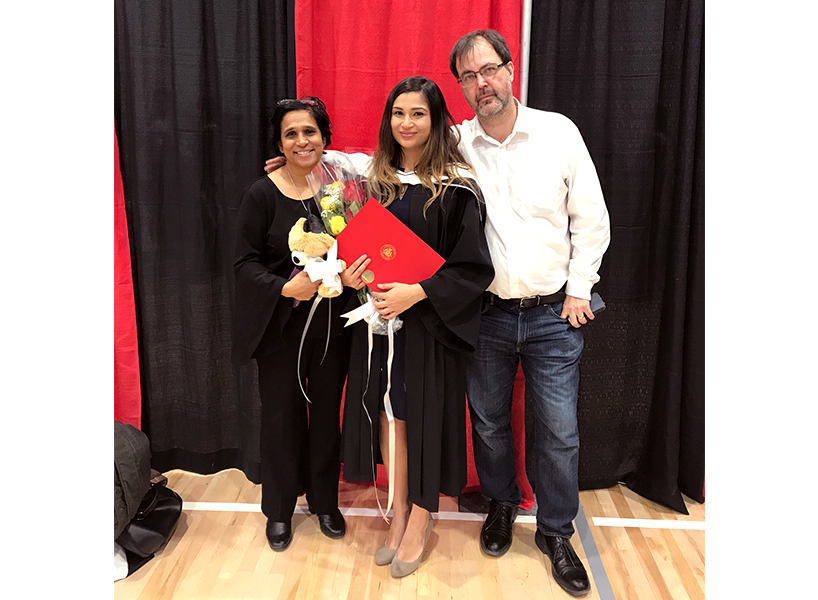 Olivia Bowden poses with her mother, who is of Indian descent, and her father, who is of European descent, at her graduation