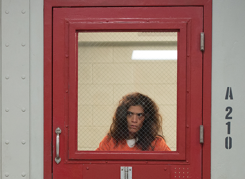 Orange is the New Black Season 6 star Blanca (Laura Gómez) is seen looking out from her cell window