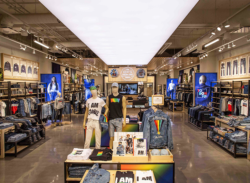 A retail space with displays of denim and mannequins at Levi's in Toronto