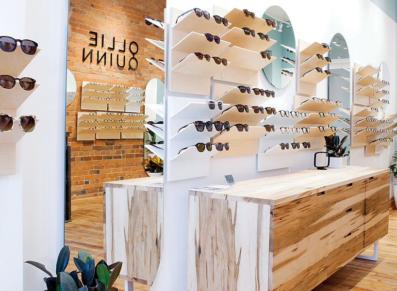 A sunglasses shop with a rustic chic interior, sunglasses and brushed wooden cabinets