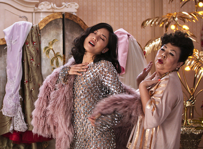 A scene from Crazy Rich Asians of Rachel Chu (Constance Wu) dressing up in lavish clothes