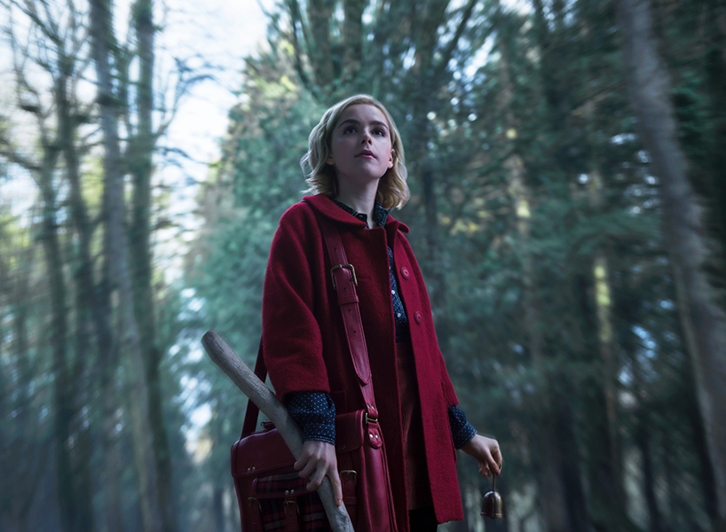 Chilling Adventures of Sabrina Kiernan Shipka in forest wearing red cape