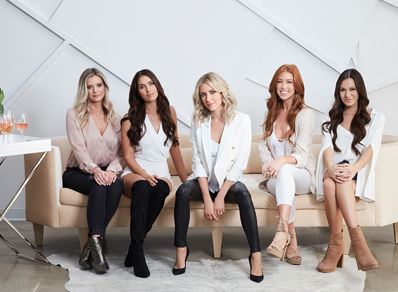 The cats of Very Cavallari posed on a couch with Kristin Cavallari in the middle