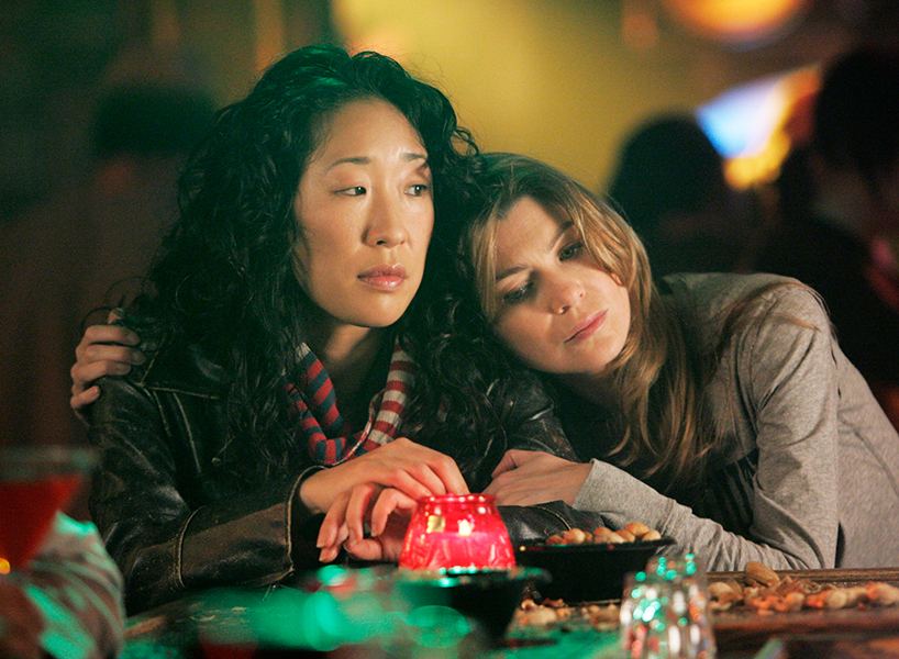Sandra Oh and Ellen Pompeo comfort each other while looking sad