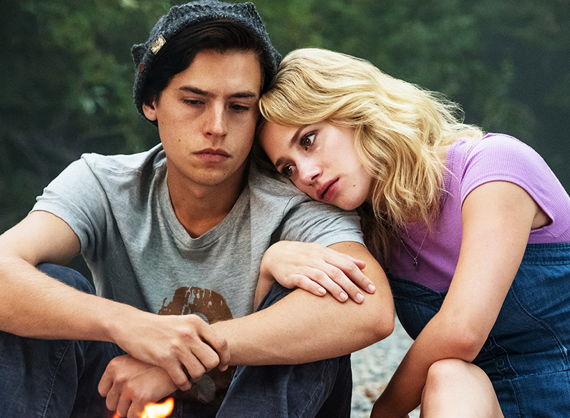 A scene of Jughead and Betty Cooper snuggling from Riverdale