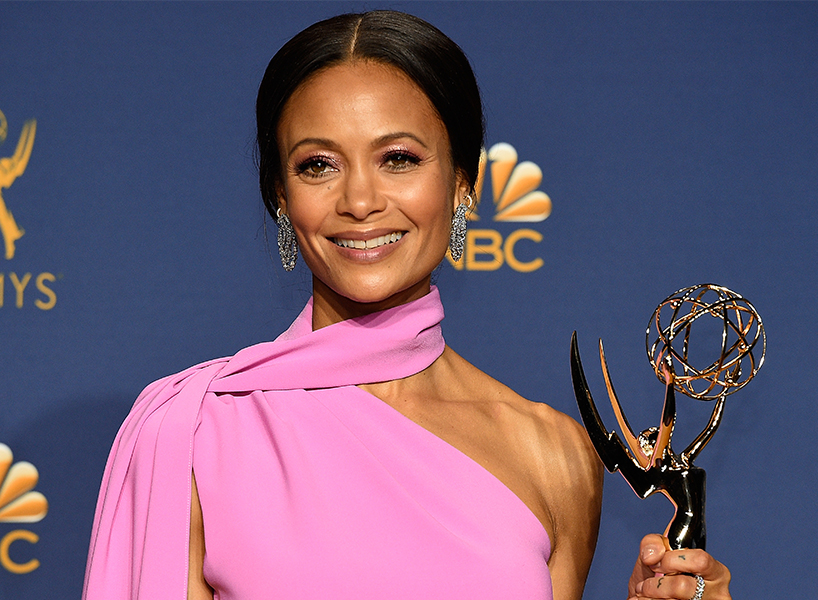 Emmy Awards 2018: Thandie Newton wears a bring pink dress and accepts her Emmy award at the 2018 award show