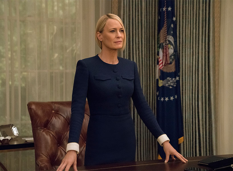 claire underwood on house of cards as the president poses behind the desk in the oval office