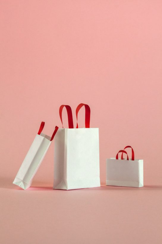 35a8f98bba3b8 Black Friday Sales 2018  white shopping bags on a pink background