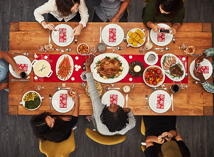 An overhead view of a family holiday dinner