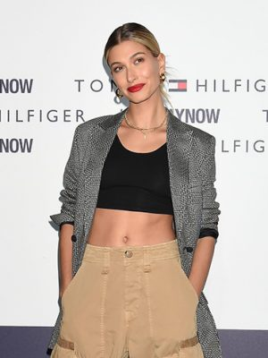 Model Hailey Baldwin poses on a red carpet