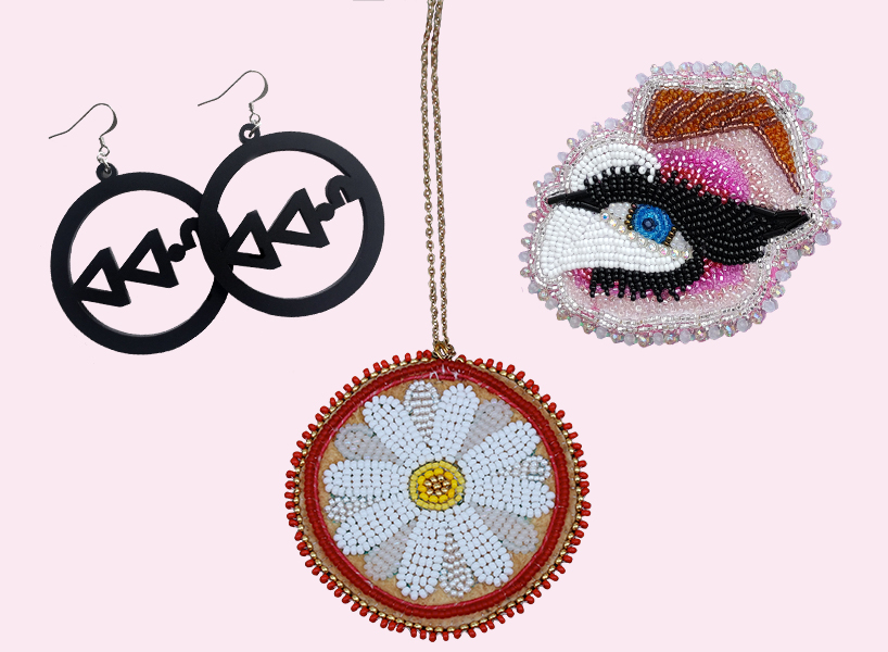 feminist gifts: black hoops, beaded daisy necklace, and trixie mattell's eye pin