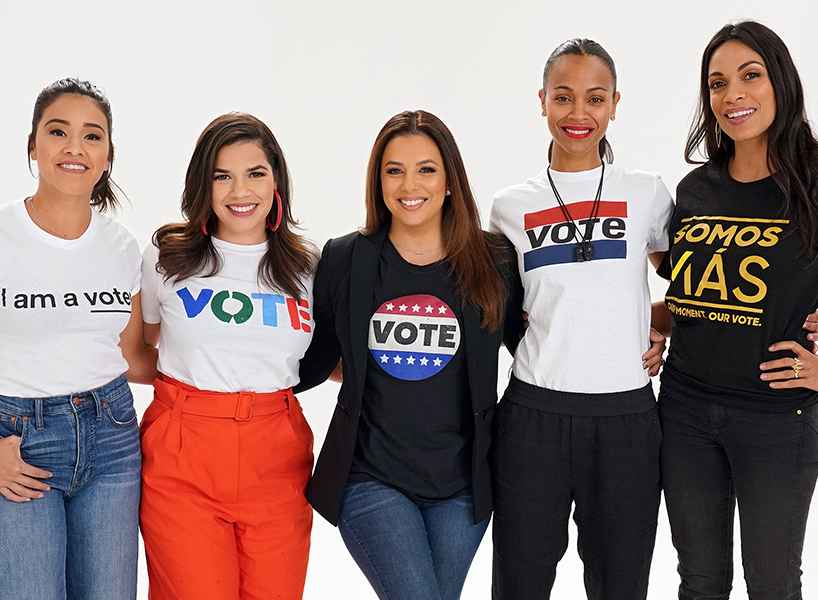 Wearing t-shirts that encourage people to vote in the upcoming 2018 US midterm elections, Eva Longoria, America Ferrera, Gina Rodriguez, Zoe Saldana and Rosario Dawson pose before participating in the Latinas Stand Up rally on Nov. 4 in Miami. (Photo: Alexander Tamargo/Getty Images)