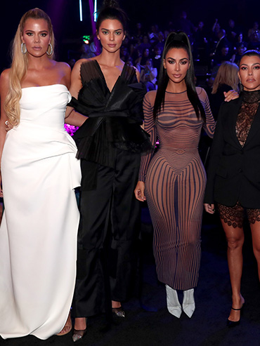 Khloe, Kim and Kourtney Kardashian stand with Kendall Jenner at the 2018 People's Choice Awards