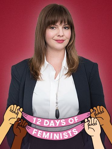 Amber Tamblyn in white shirt and blazer with 12 days of feminist banner overlay