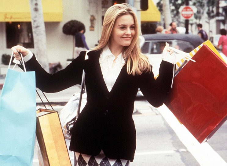 A scene from Clueless featuring Cher holding shopping bags
