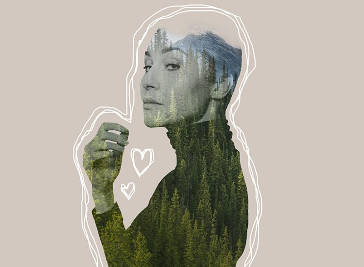 Double exposure of a woman and a forest