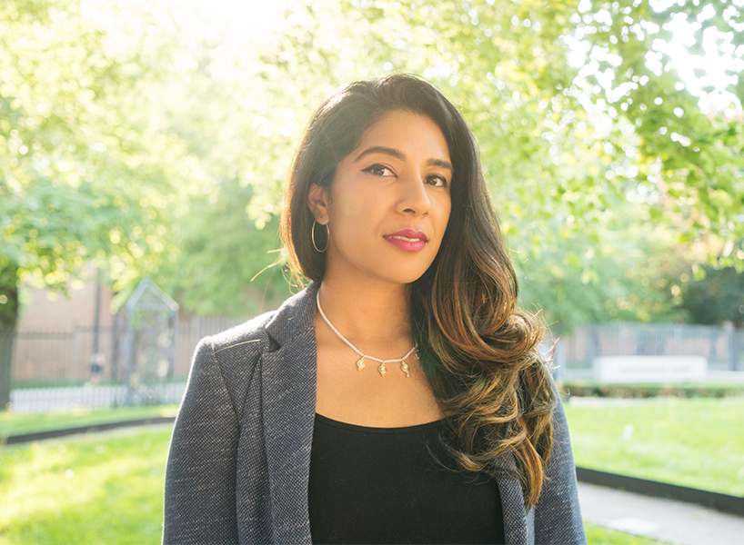 millennials voter barriers: headshot of Seher in grey blazer and black shirt
