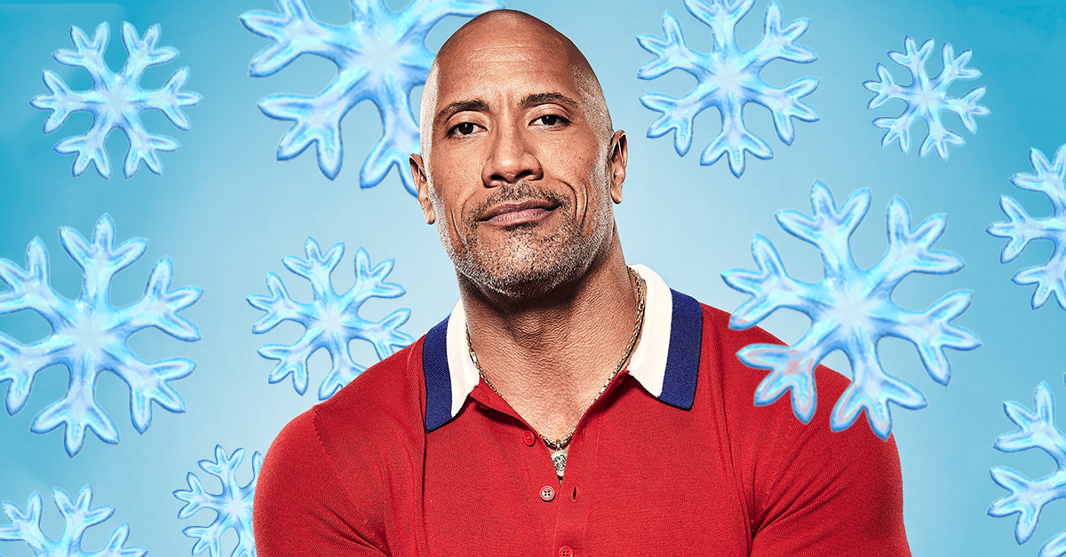 Dwayne Johnson, aka The Rock, poses in a red shirt with snowflakes around him looking serious