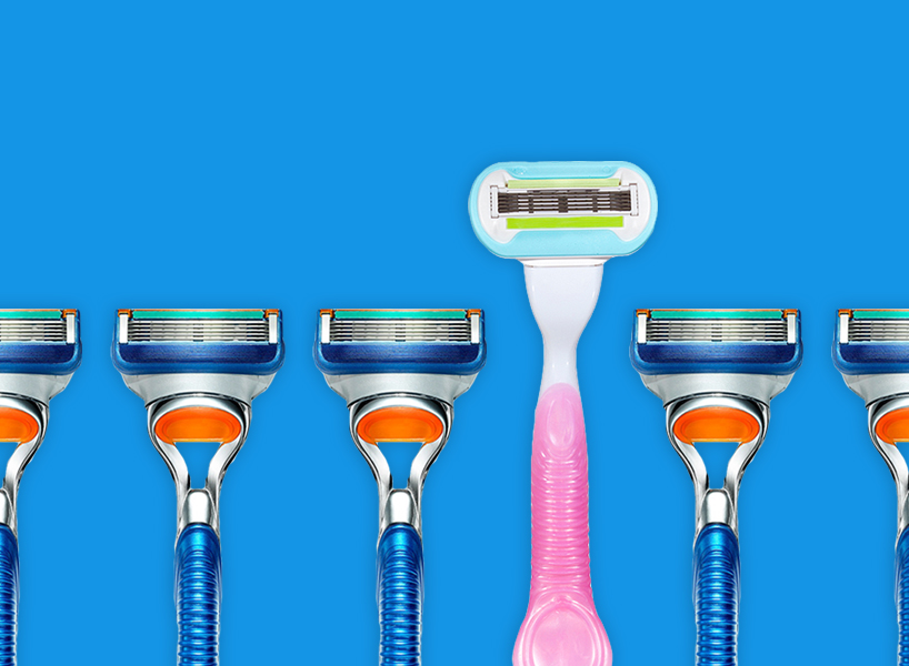 A photo of Gillette men's and women's razors next to each other, one is pink and pastel and the other is blue and orange. The image is tied to Gillette's toxic masculinity commercial