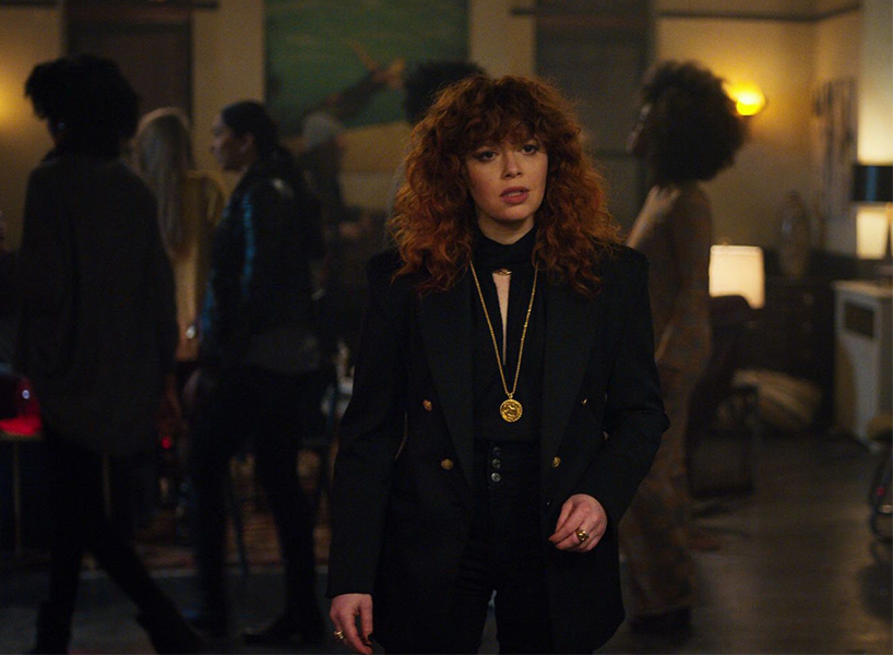 Natasha Lyonne stands in a crowded room on the Netflix show Russian Doll