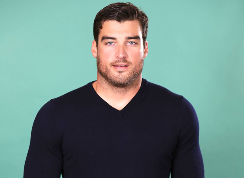 Season 15 Bachelorette contestant Tyler G. wearing a black shirt and posing for the camera.