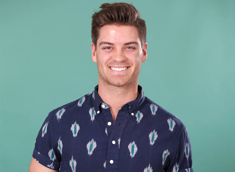 The Bachelorette's Garret P wearing a print shirt and smiling at the camera.
