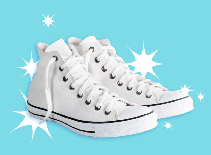 How to clean white sneakers / A pair of white canvas hightop sneakers against a teal background with white starbursts