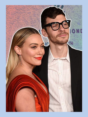 Hilary Duff and new hubby Matthew Koma looking fancy against a red-blue gradient background and light blue border.