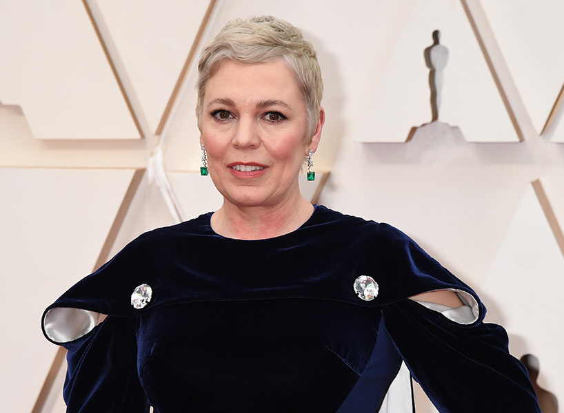 celebrity hair 2020: Olivia Coleman poses on the red carpet in a black gown with blonde hair