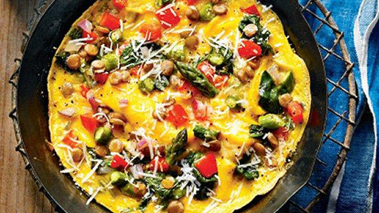 Overhead shot of a vegetable omelette in a cast-iron skillet