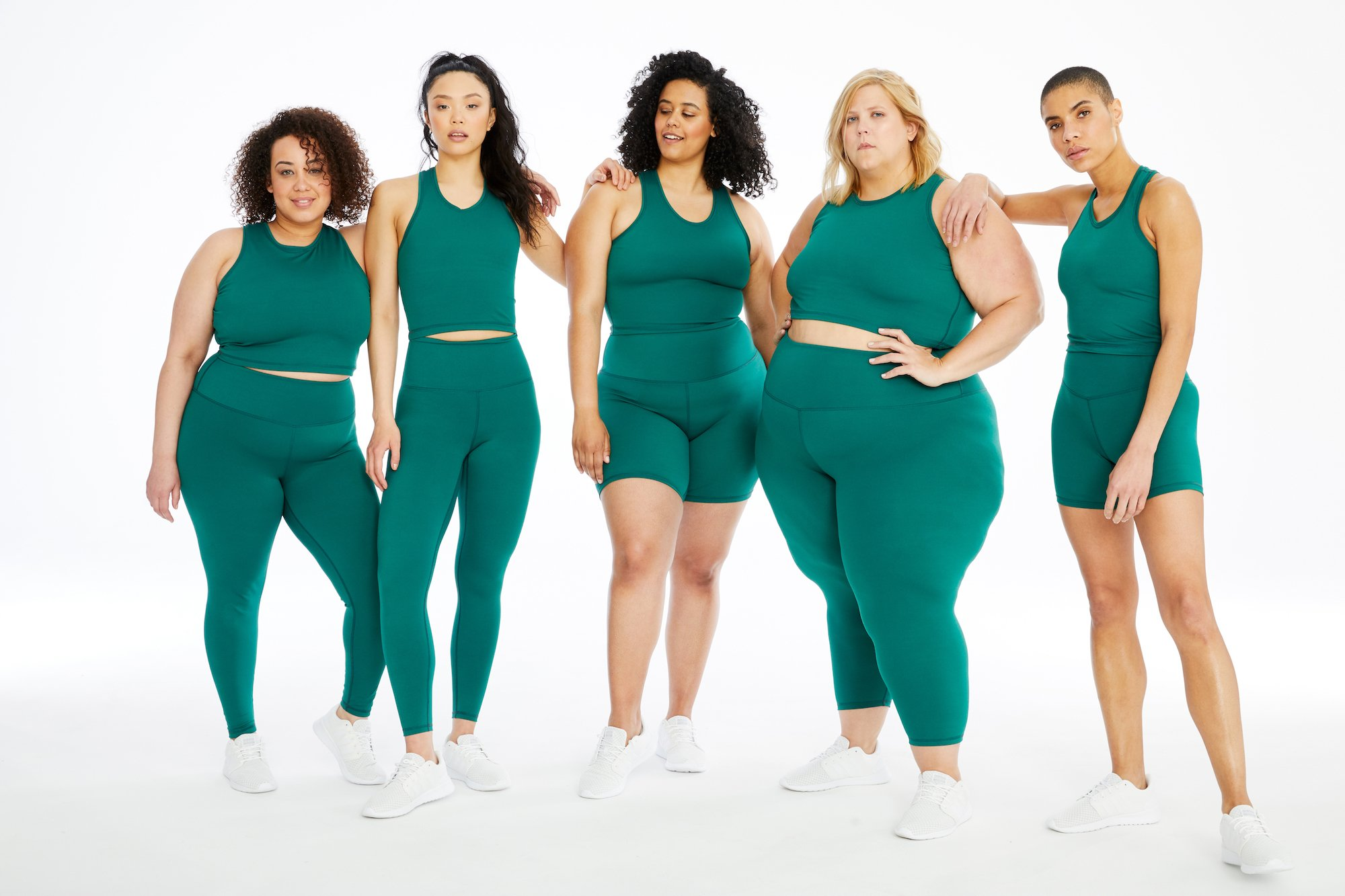 Five women model green activewear from brand Day Won.
