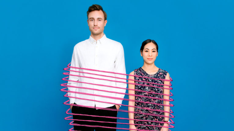 how will couples cope with separation post COVID: A couple stands side by side with a pink rope tying them together