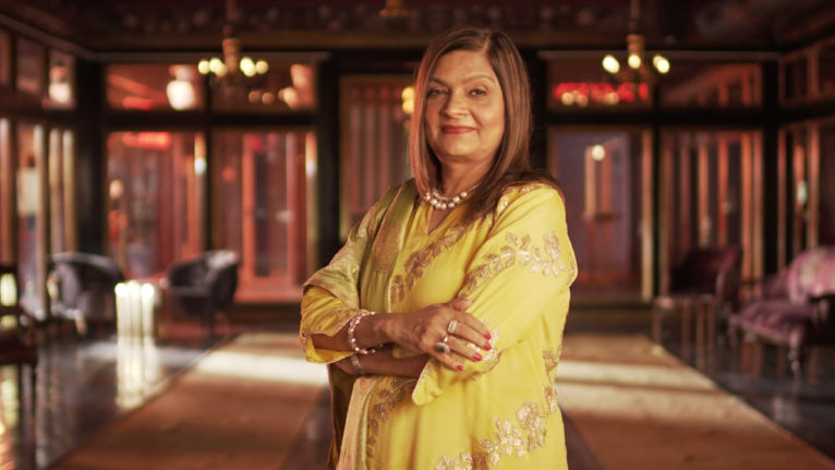 indian matchmaking netflix criticism unfair: Sima Aunty poses in a yellow outfit