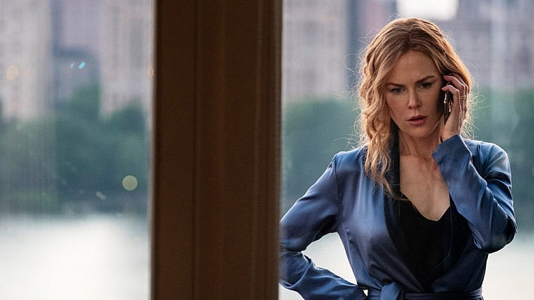 the undoing finale questions: Nicole Kidman as Grace Fraser in a still from 'The Undoing.' She's on the phone, looking frustrated. Her curly hair is tied in a low ponytail and she's wearing a black shirt and blue silk robe