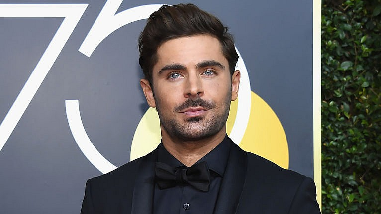 celeb hairstyles 2020: Zac Efron poses on the red carpet in suit