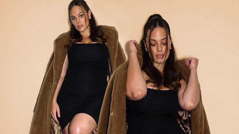 Ashley Graham wearing a black dress and a teddy coat